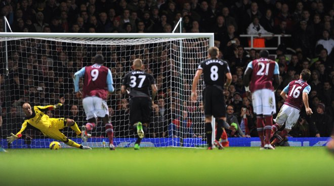 Nobes puts away his penalty.