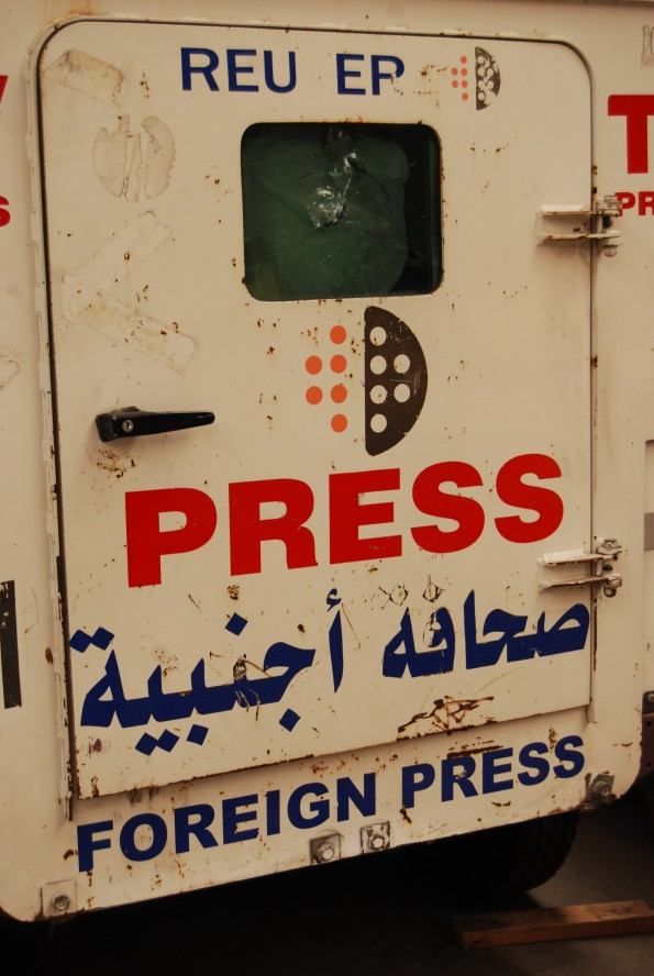 Nice bullet holes this press vehicle recovered from the Middle East.