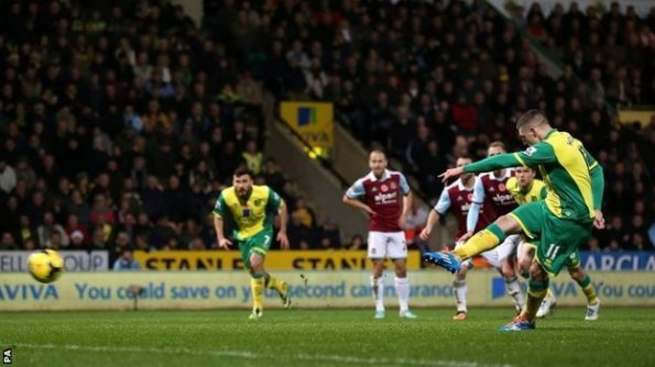 Joe Cole looks on as Robert Snodgrass gives Norwich the lead.
