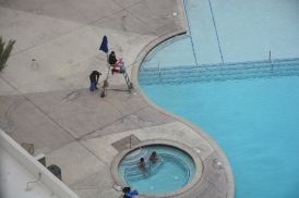 Stalker photo of bikinis and woolly hats (if you zoom in). Life guard doesn't look warm either.
